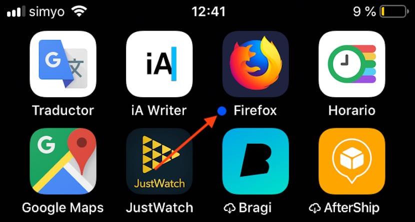 Punto azul delante aplicaciones iPhone